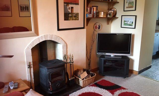 Mc Murray - Sitting room - tv and stove.